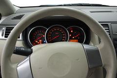 Steering wheel and dashboard. Closeup shot of a steering wheel and dashboard of a new modern car Royalty Free Stock Photo