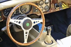 Steering wheel and dashboard of an antique car Royalty Free Stock Image