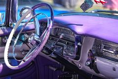 Steering wheel and dashboard of 1956 Cadillac Eldorado Biarritz. Dashboard of this 1956 Cadillac Eldorado `Biarritz` is bright and colourful in the sun, with royalty free stock photography