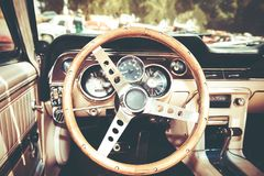 Steering wheel and dashboard in interior of old retro automobile. Royalty Free Stock Photo