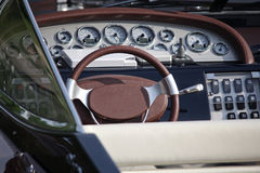 Steering wheel and dashboard of a luxury yacht. Transport Royalty Free Stock Photo