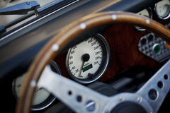 Steering wheel and dashboard. In a sports car Royalty Free Stock Photos