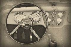 Steering wheel and dashboard in vintage car, illustration. Steering wheel and dashboard in historic vintage car. Illustration of retro automobile interior. Old Royalty Free Stock Images