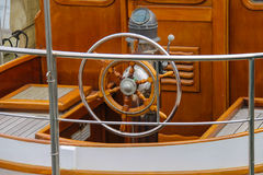 Steering wheel on the deck of a boat Stock Image