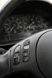 Steering wheel detail. Steering wheel with light and sound control buttons Stock Images