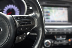 The steering wheel features cruise control. Buttons forward back stock photos