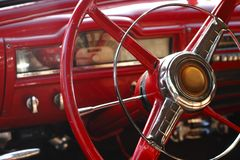 Steering wheel of a fifties american car. Close up of a steering wheel of a fifties american car Royalty Free Stock Image