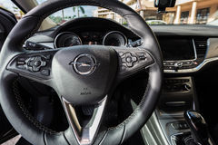 Steering wheel  and front console closeup of Opel Astra Stock Image