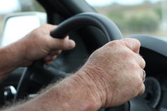 Steering wheel and hands driving Stock Photography