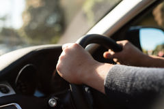Steering wheel. Hands on a steering wheel, right hand drive Royalty Free Stock Image