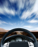 Steering wheel on a highway Royalty Free Stock Images