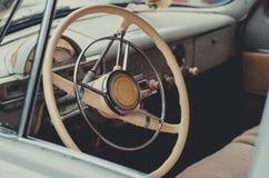 Steering wheel and inside interior of the retro soviet car. Steering wheel and ine interior of the vintage soviet car volga Stock Photos