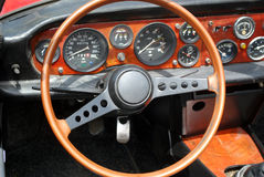 Steering wheel interior of vintage car. Steering wheel interior of old vintage car Stock Photos