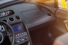Steering wheel and interior view of car. Dashboard with fade style Stock Photography