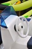 Steering wheel of light boat Stock Images