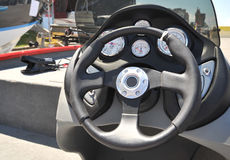 Steering wheel of light boat Stock Photos