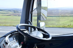 Steering wheel in lorry. Cab, view of  dashboard and side mirrors Stock Photos