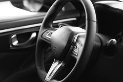 Steering wheel of a luxury car Royalty Free Stock Images