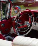 Steering wheel and a mirror in an old classic car Royalty Free Stock Photo