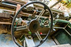 Steering wheel of a old rusty car wreck, interior of a wrecked vehicle stock image