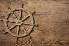 Steering wheel over wood background Stock Photos