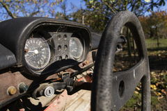 Steering wheel and rusty speedometer on vintage car dashboard Royalty Free Stock Photos