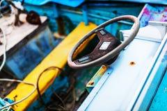 Steering wheel sailboat old use Stock Photos
