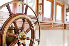 Steering wheel. On a ship royalty free stock images