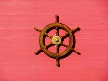 Steering wheel of the ship on a pink wall Stock Photography