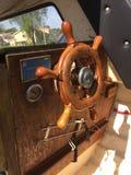 Steering wheel. Steerong wheel on old boat Royalty Free Stock Images
