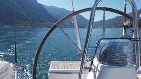 Steering wheel is at the stern of the yacht