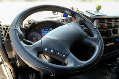 Steering wheel in a truck. Cabin of a truck: steering wheel, dashboard royalty free stock image