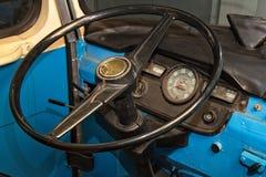 Steering wheel of vintage bus. Vintage blue bus. Black steering wheel. Dashboard Stock Photos