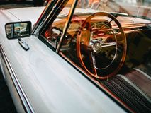 Steering wheel in a white car royalty free stock photography