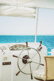 Steering wheel white yacht on a background of blue sea Stock Images