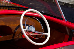 Steering wheel in a wooden boat Royalty Free Stock Image
