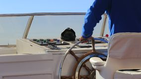 Steering wheel on yacht stock video