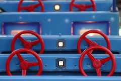 Steering wheels. At a funfair Royalty Free Stock Images