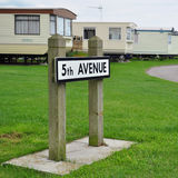 Steet sign 5th avenue in caravan camp. Trailer park with a street sign 5th avenue on grassy lawn, taken near Skipsea, Driffield, UK Royalty Free Stock Photo