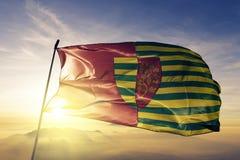 Stefan Voda District van stof die van de de vlag de textieldoek van Moldavië op de hoogste mist van de zonsopgangmist golven royalty-vrije illustratie