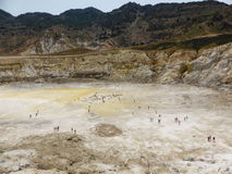 Stefanos crater. The volcano on the island of Nisyros. Greece. Tourists walking inside the crater Stock Images