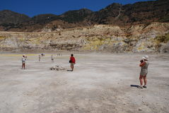 Stefanos volcano, Nisyros. Tourists walking inside the Stefanos volcano crater on the Greek island of Nisyros on June 12, 2010 Royalty Free Stock Image