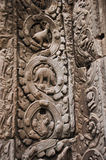Stegosaurus dinosaur carving on the wall in Ta Prohm temple Stock Image