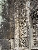 Stegosaurus dinosaur carving on the wall in Ta Prohm temple, Siem Reap, Cambodia.  Royalty Free Stock Image