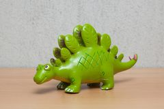 Stegosaurus dinosaur toy on wooden table. Stock Image