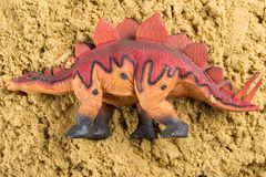 Stegosaurus on sand. Concept of historical animal excavating Stock Photos