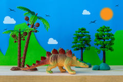 Stegosaurus toy model on wild models background. Closeup Stock Images