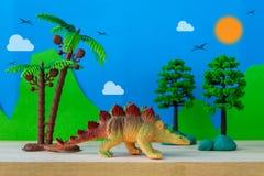 Stegosaurus toy model on wild models background Stock Images