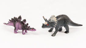Stegosaurus and triceratops dinosaur toy models. Isolated on white background Stock Photos