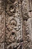 Stegosaurusdinosaurus het snijden op de muur in de tempel van Ta Prohm Stock Afbeelding